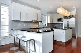 kitchen peninsula with seating modern kitchen with absolute black granite counter peninsula cherry wood floors and piston stools with