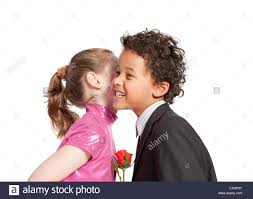 cute little kissing a boy stock image