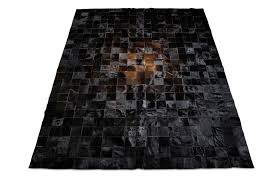 brown and black patchwork cowhide rug in 4 inches squares