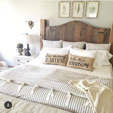 country beach style bedroom decor idea. omg i love this farmhouse bedding with the ticking stripe duvet and wood headboard country beach style bedroom decor idea