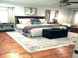 how to put a rug under a bed bedroom area rug ideas area rug under bed