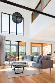 Double height ceiling design living room contemporary with pendant light  white walls modern furniture