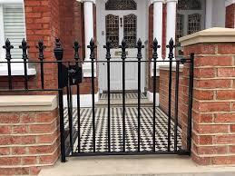 red brick front garden wall heavy rails gate victrorian mosaic tile path battersea clapham fulham chelsea london