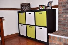 minimalist white and yellow box storage baskets for toys with furnctional black wooden shelving units for kids from kids furniture ikea