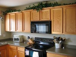 Decorate Kitchen Countertops Decorate Above Kitchen Cabinets Simple Varnished Mahogany Wood