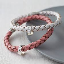 personalised leather hoop bracelet top to bottom white and pink options oxidised lettering