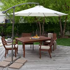 Furniture Ideas Patio Dining Set With Umbrella And Wooden Deck