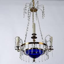 small swedish chandelier with brass frame cobalt blue glass bowl three candle style lights