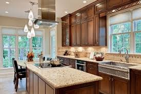 Stainless steel and a darker stain on the cabinets mark this Craftsman  kitchen as having a