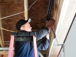 image of repair the broken garage door spring
