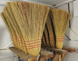 Rows of completed brooms hang near the door of Gene's shed. In addition to house  brooms, he also makes a hand-held whisk broom, a child's broom and a larger  ...