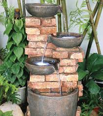 4 bowls on brick wall water feature