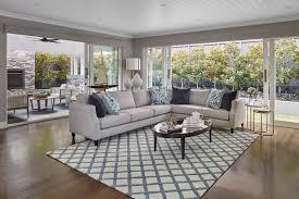 hamptons living room hamptons home with grey sectional sofa and blue and white rug