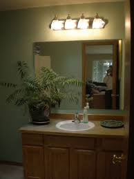 terrific bathroom lighting over mirror 15 bathroom lighting ideas wall lamps on top and mirror and vase with plant and sink faucet and soap and wooden
