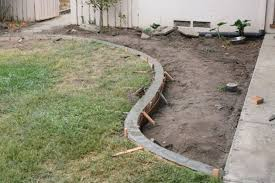 Level the concrete. installation DIY yard curbs curbing border lawn  landscape