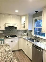 white glass subway tile stunning remodeled kitchen using ice gray backsplash with grout