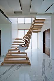 Double Storey Stairs Designs Sculptural Staircase Defines A Modern Two Storey Apartment