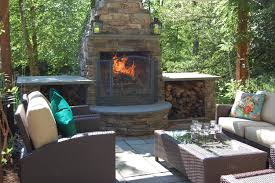 outdoor fireplace vs fire pit from 13 backyard covered patio with fire pit source