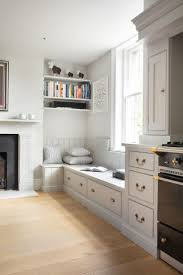 extra living room seating ideas. georgian farmhouse kitchen, hampshire - humphrey munson kitchens banquette seating next to the lacanche range cooker with storage drawers underneath. extra living room ideas t