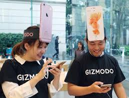 iphone japan. customers makiko maeda (left) and naoki tsukamoto react after purchasing the new iphone 6s iphone japan w