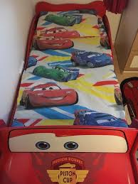 lightning mcqueen toddler bed barely been slept in also have quilt cover and rug