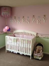 Pink and gold nursery for our baby girl. Pink and cream striped wall with  modern