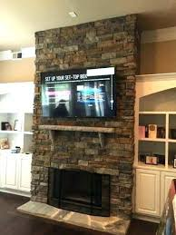 zen style painted stone fireplace makeover with flat black slate hearth pillows designs