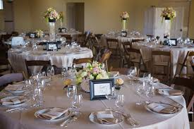 overview of wedding dinner round tables place settings and centerpieces