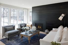 a bold dark stained plank wall makes a statement in ivory surrounding walls and windows