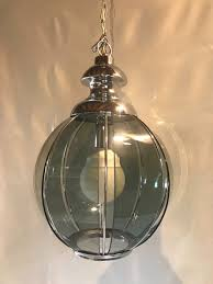 vintage design chandelier in chrome steel with large smoked glass facets year 70