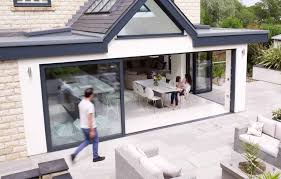 family in kitchen with sliding doors opening onto patio