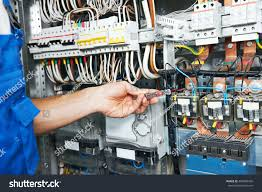 electrician works electric meter tester fuse stock photo (royalty how much to move electric meter and fuse box electrician works with electric meter tester in fuse box