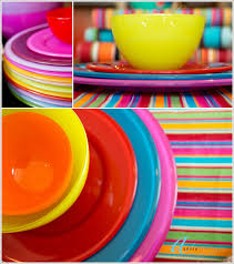 yellow blue red pink plates and brightly coloured tableclothsthe fabulous asti range of
