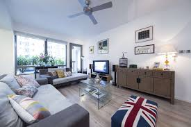 the edwards made the sofa cushions themselves with fabric bought overseas the union flag ottoman and coffee table were bought years ago while