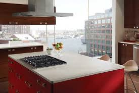 artificial stone countertop and red kitchen cabinets ...