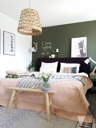 green wall behid bed scandinavian style bedroom with dark green wall we examine the