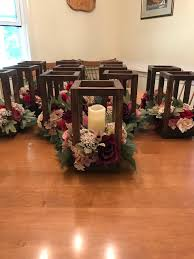 wooden lantern centerpiece with flameless candles