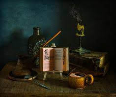 still life with a book look on the dark background