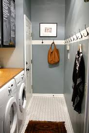 laundry room. I love the hooks for clothes and the counter placed on top of