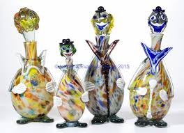 assorted murano art glass clown decanters lot of four