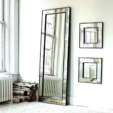 leaning wall mirror above the hanging from based design is meant to stand against a as