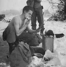 battle of the bulge  rare photos from hitler    s last gamble   timean american artilleryman shaves in frigid cold  using a helmet for a shaving bowl