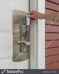 safety and security hand inserting a keycard in hotel door lock