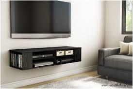 floating shelf under flat screen tv