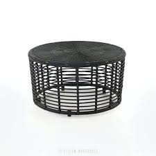 black round wicker coffee table with baskets full size
