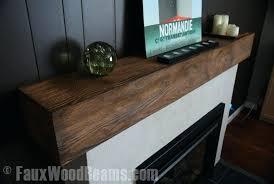 faux wood fireplace mantels even a simple faux wood beam as a fireplace mantel can give