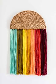 a beautiful wall hanging that sort of resembled a reverse rainbow this one packs all of the charm of a more complicated fiber piece and can be made in