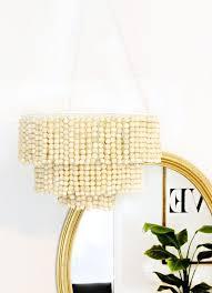 description love this diy wood bead chandelier for tutorial