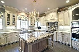 white cabinets with granite traditional luxury kitchen with antique white cabinets chandelier granite island and mosaic white cabinets with granite