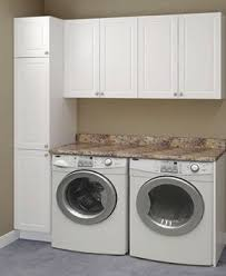 cabinets above washer and dryer. pinning this for the idea of countertop over washer \u0026 dryer. would love to do when i redo my kitchen counters! | decor pinterest dryer cabinets above and e
